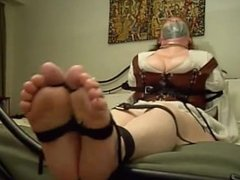 cute chubby girl securely tape gagged with her soles exposed