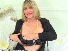 British granny Alisha Rydes loves wearing stockings when she masturbates