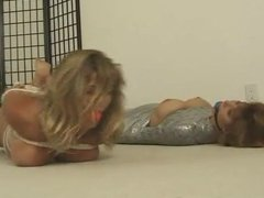 One girl mummified, one hogtied