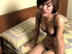 Short hair Thai tranny jerks off and cums