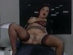 Gorgeous German secretary in stockings fucked on the desk