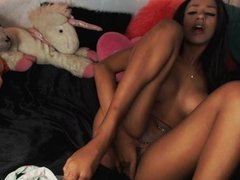 stripteasing & fingers her tight pussy on cam
