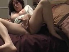 Hot milf enjoy with the dildo in the cunt