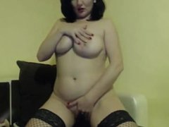 Tasty brunette cougar with British accent and big tits