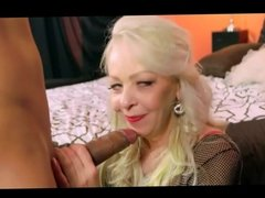 Flexible mature lady takes young cock