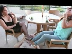 Slave lick feet of two mature
