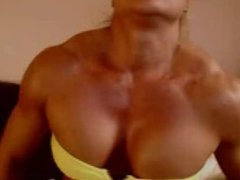 Woman flexing Huge traps and pecs