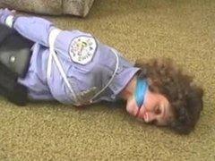 policewoman hogtied on floor