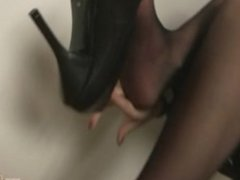 Dominant Secretary Foot Teasing in Dark Stockings and Black Pumps