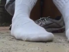 Heidi puts white hooters socks back on her feet after showing bare feet