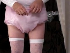 diapered sissybaby in choker and chastity