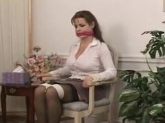 Alexis Taylor chair tied and bandanna gagged