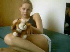 girl using plush toy