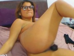 Attractive Busty Brunette with Glasses Video
