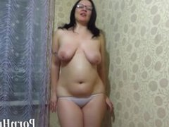 mature milf with big tits, pissing into a bowl with shorts