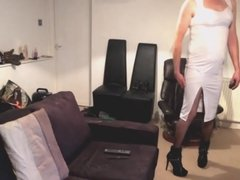 Maninboots in white dress fishnets and high heels prancing