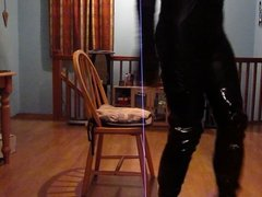 Wearing a sexy black catsuit & thigh high boots