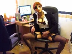stripping out of a secretary outfit to reveal sexy basque