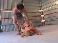 Wrestling Rub her face and tits in the mat