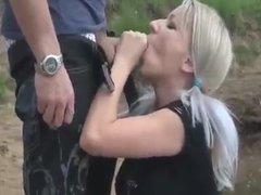 Blonde cum slut sucks cock in the river bank