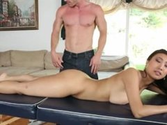 Pretty asian gets an oily massage