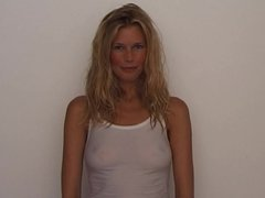 Claudia Schiffer showing nipples in a see-through shirt