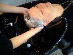 Creamy shampoo in salon sink