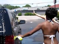 Girls in bathing suits at a car wash Jeep