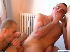 A nice innocent guy serviced his big cock by 2 guys in spite of him!