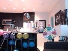 Webcam girl has fun with a cake!