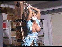 Nurse tied to pole
