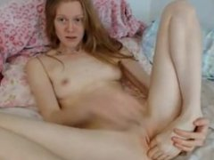 Hot redhead plays with her feet