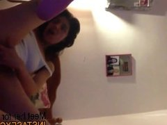 Stunning black haired beauty teases on cam