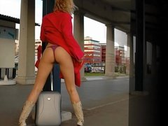 Naked under the coat at the train station slide show