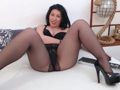 Beautiful girl in black pantyhose teasing