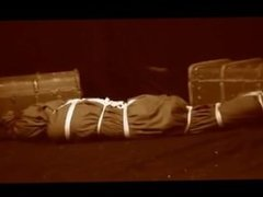 girl bound and gagged in a bag struggling