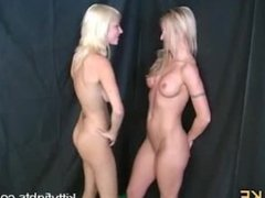 Two Sexy Thin Blondes Punching Each Other in The Belly