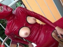 Girl in latex masturbates with a ball vibrator on the balcony part 2