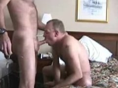 Old hairy man gets a blowjob in a motel room