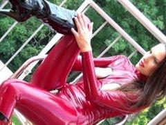 Girl in latex masturbates on the balcony with vibrators part 1