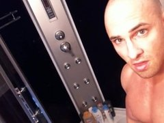 SHAVED BODYBUILDER IN SHOWER