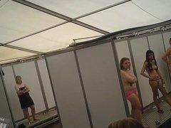 A crowd of women in public shower -2