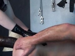 Kinky Mistress with huge tits and latex fucks slave with massive strapon