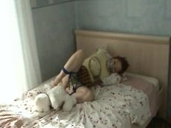 Frogtied and tape gagged on the bed