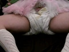 diapered sissy dressed up as beerwench locked in chastity cage and diaper