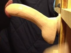 Sissy practices in deepthroating with huge dildo
