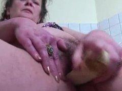 Mature masturbating with vegetables