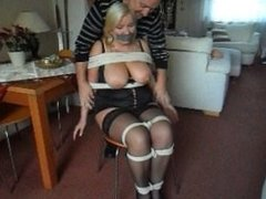 mature blonde chair tied