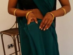 Cute belly button on a tutorial about how to wear a saree