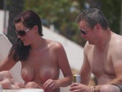 Old guy sunbathing with young hot topless wife